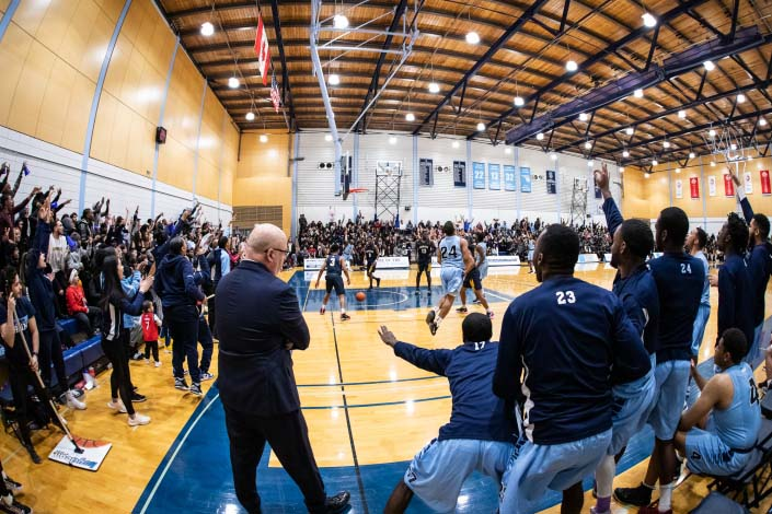BRAMPTON, ON - FEB. 15, 2019: The stadium erupts during the 121st edition of 'The Game' between the Sheridan Bruins and the Humber Hawks.