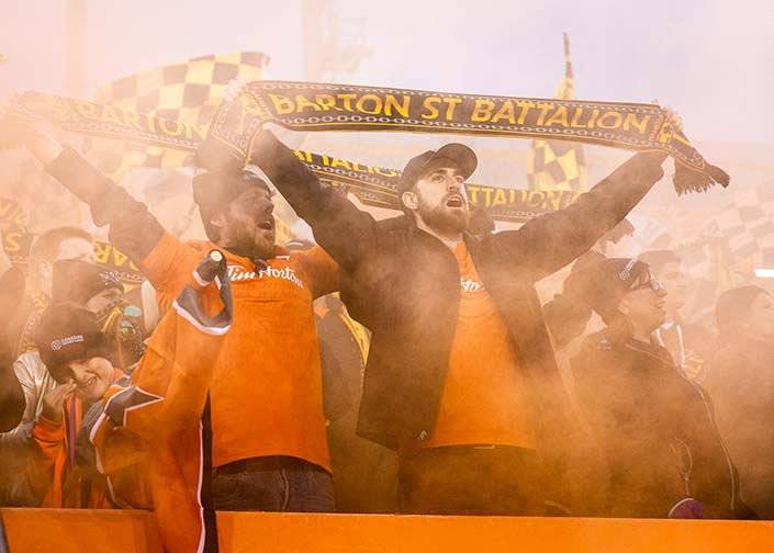HAMILTON, ON - OCT. 26, 2019: Forge FC fans celebrate at Tim Hortons Field after a 1-0 win over Cavalry FC in the first leg of the Canadian Premier League Finals.