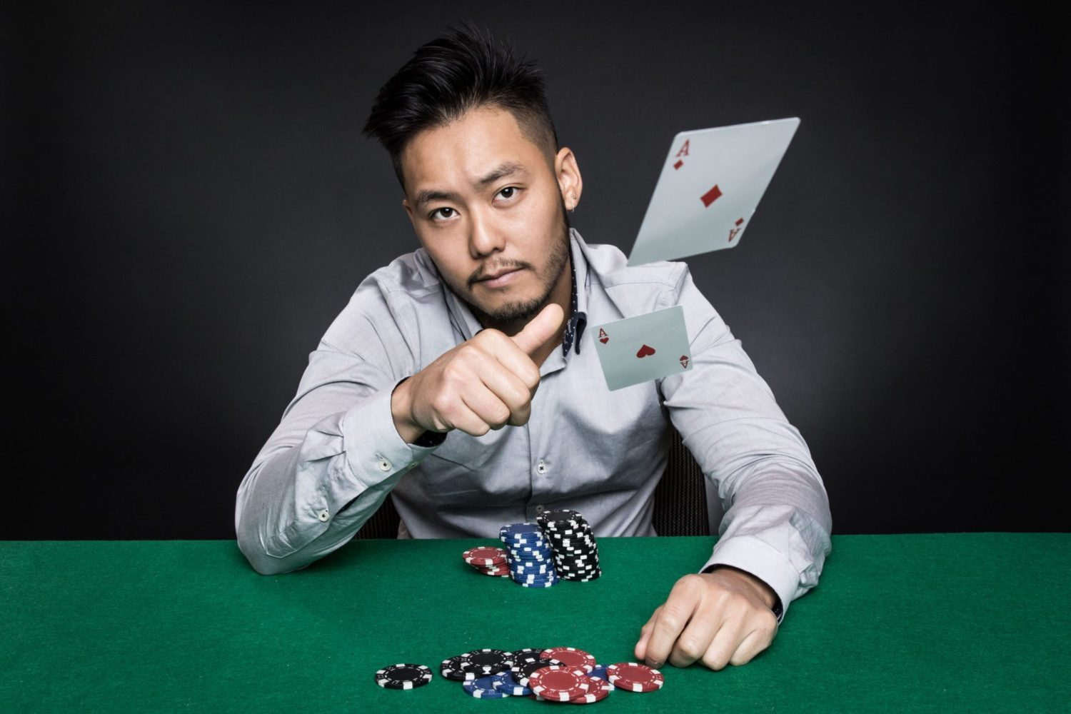 Lifestyle Photography – Poker Player Throws Cards at Camera