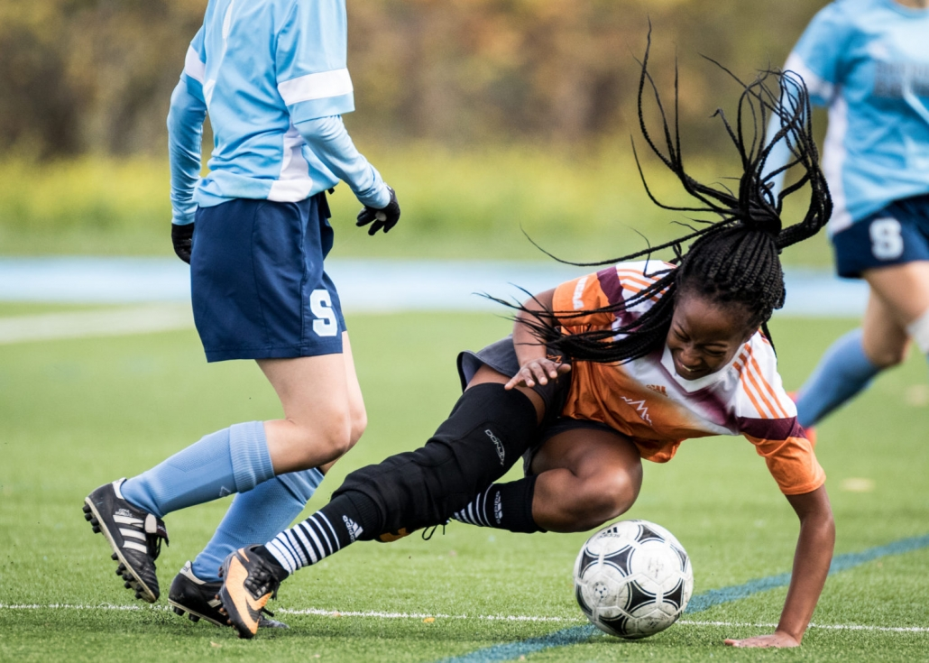 OAKVILLE, ON - Oct. 22, 2016: A Mohawk player falls to the ground after a crunching tackle.