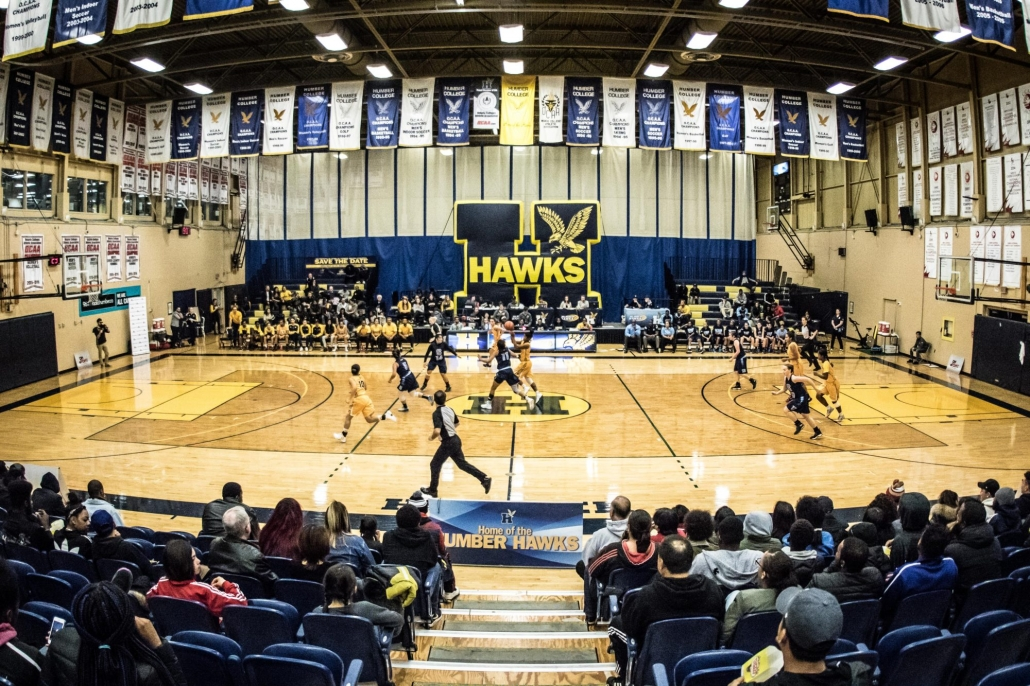 TORONTO, ON - Nov. 12, 2016: Fisheye angle from the stands in a game between the Humber Hawks and the Sheridan Bruins.