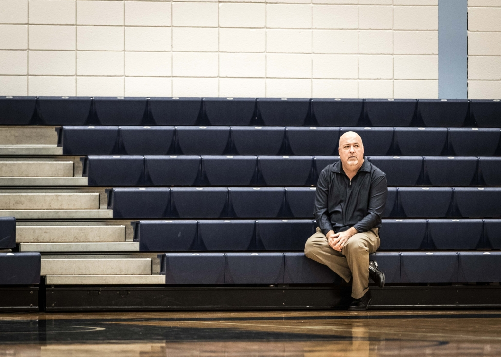 BRAMPTON, ON – Nov. 27, 2016: Head coach Jim Flack of the Sheridan Bruins men's basketball team watches a game from the stands, following his 300th career victory.