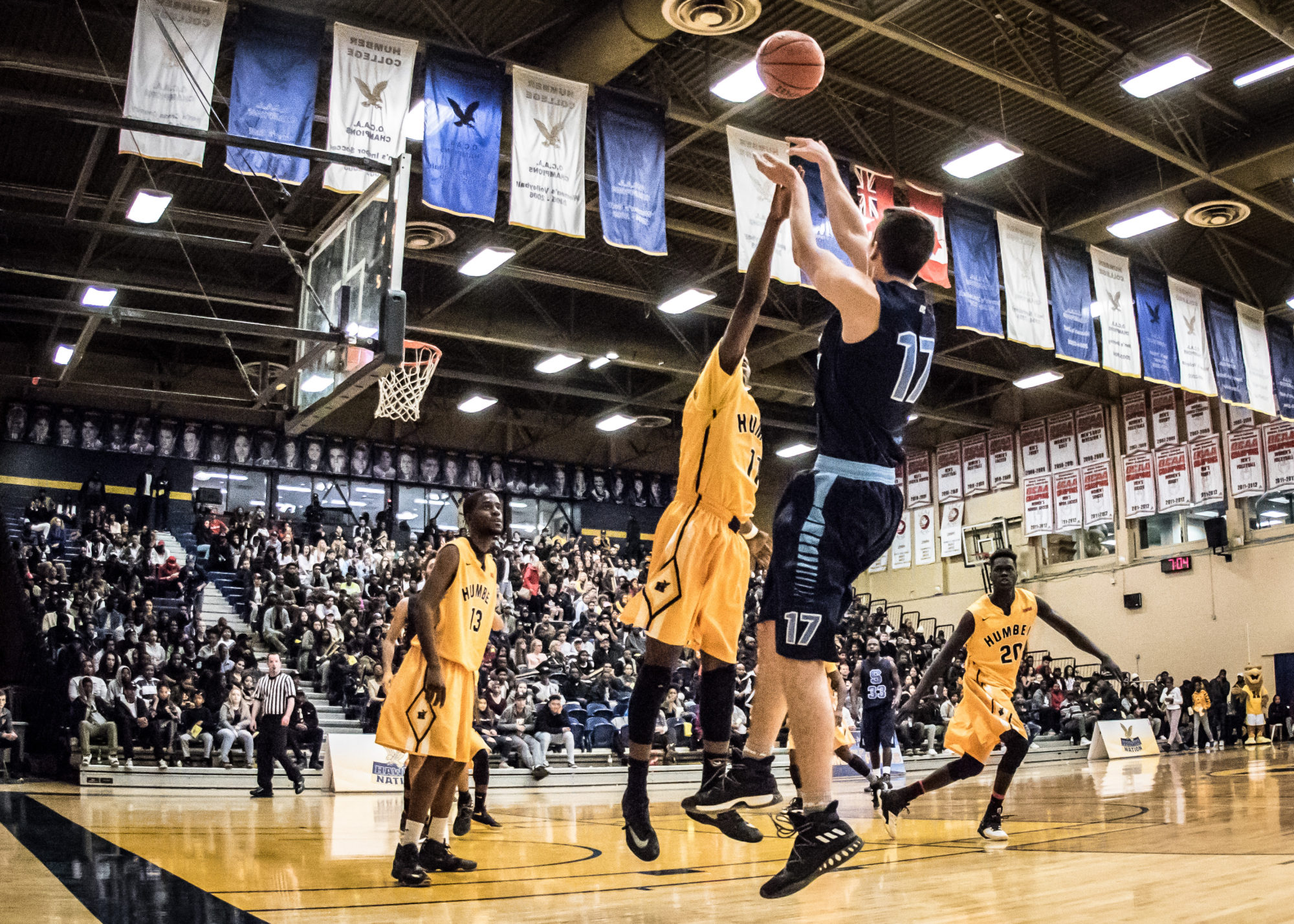 TORONTO, ON – Nov. 12, 2016: Ostap Choliy of the Sheridan Bruins releases a jumper in OCAA regular season action against the Humber Hawks.