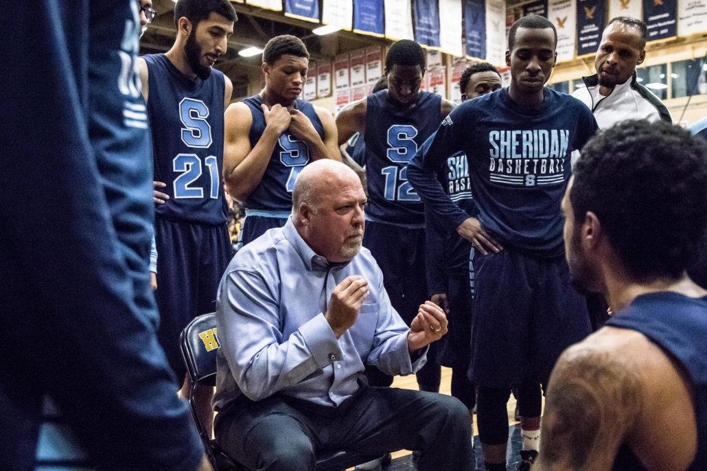 TORONTO, ON – Nov. 12, 2016: Sheridan Bruins head coach Jim Flack speaks to his players during a time-out.