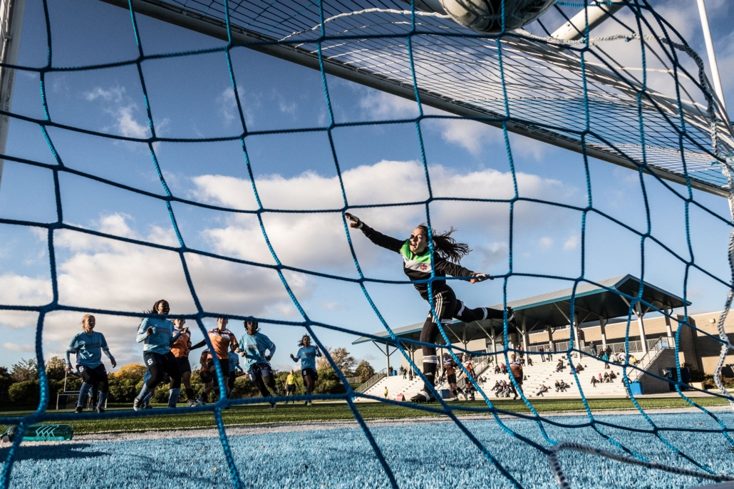 OAKVILLE, ON - OCT. 22, 2016: Mohawk Mountaineers goalkeeper dives and misses a Sheridan Bruins free kick.