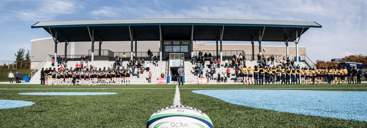 OAKVILLE, ON - NOV. 5, 2016: The Humber Hawks and Conestoga Condors line up for the OCAA's inaugural Women's Rugby Sevens championship.