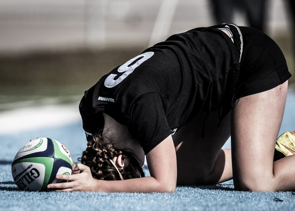 OAKVILLE, ON - Nov. 5, 2016: Seneca player collapses for a breather after sprinting the length of the pitch for a try.