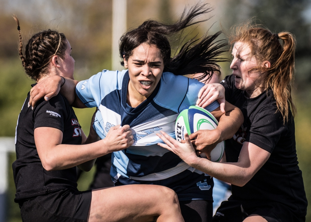 OAKVILLE, ON - NOV. 5, 2016: Sheridan player tries to get past two Seneca defenders at the inaugural OCAA Women's Rugby Sevens championship.