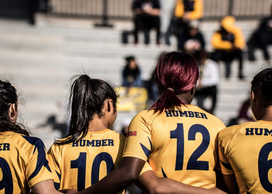OAKVILLE, ON - Nov. 5, 2016: Humber players stand together during the national anthems at the inaugural OCAA Women's Rugby Sevens Championship.