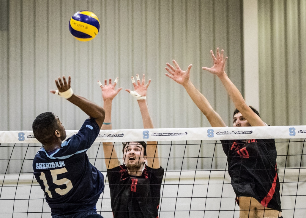 OAKVILLE, ON - Oct. 29, 2016: Shaun Lasala of the Sheridan Bruins attempts to place the ball past two Fanshawe defenders.