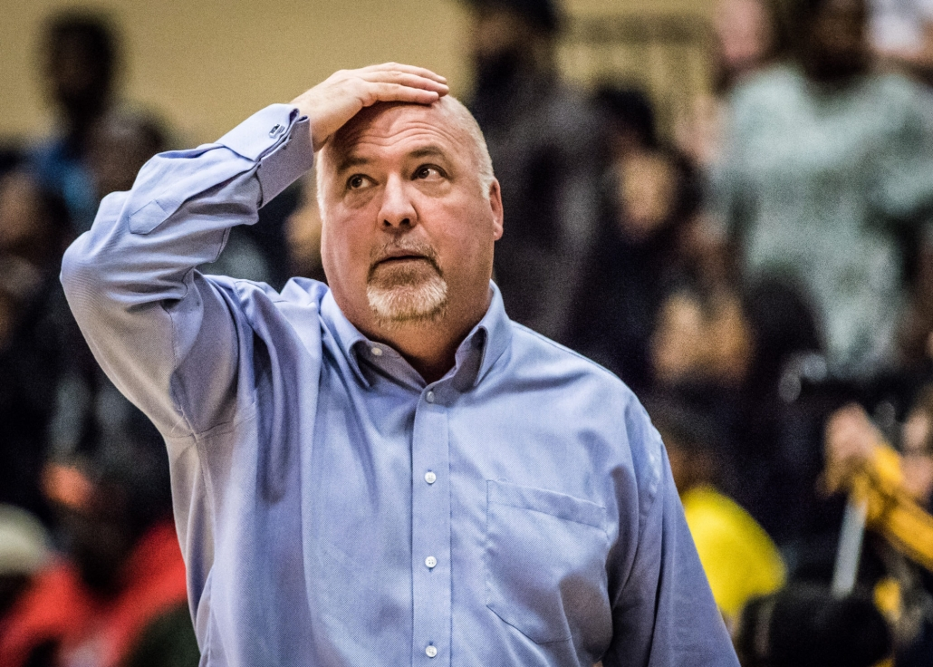 TORONTO, ON – Nov. 12, 2016: Sheridan Bruins head coach Jim Flack checks the clock with seconds to go against the Humber Hawks.