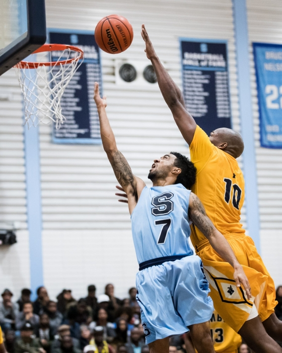 BRAMPTON, ON – FEB. 4, 2017: Dylan Periana twists and turns for a lay-up in the 100th regular season meeting between the Sheridan Bruins and the Humber Hawks.