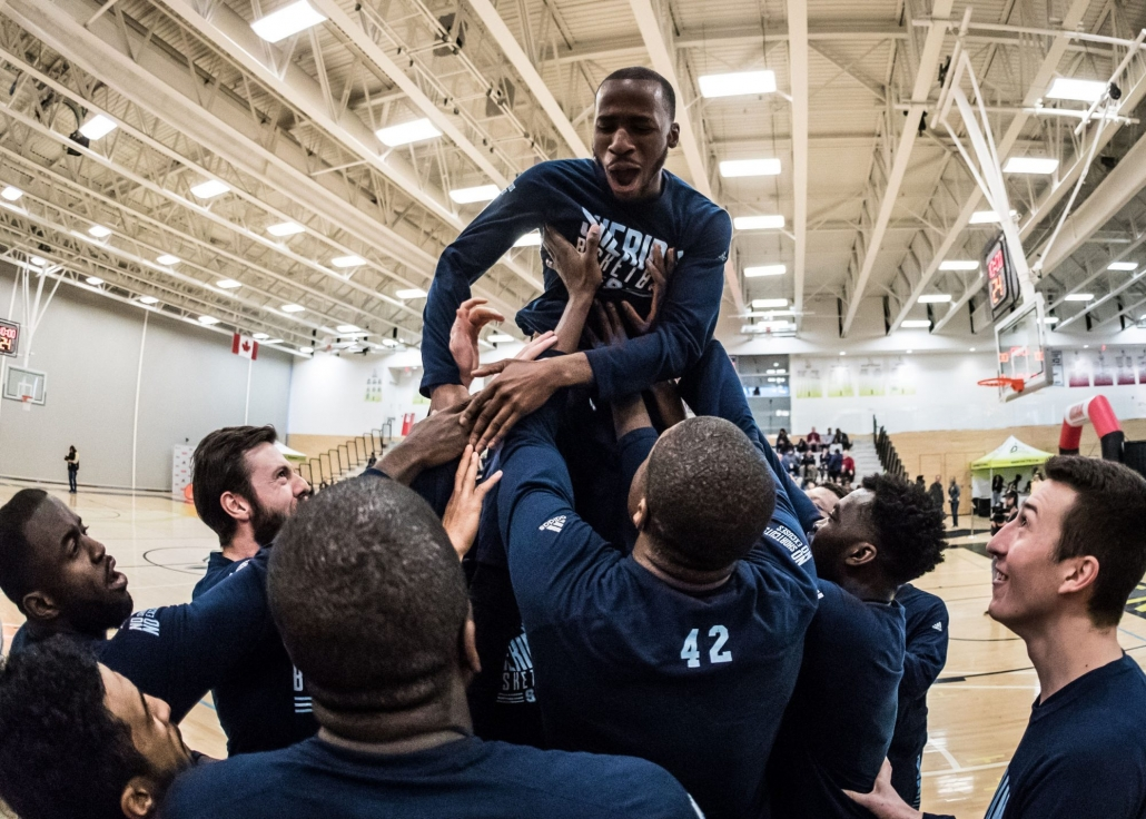 TORONTO, ON – MAR. 3, 2017: The Sheridan Bruins lift Jemol Edwards into the air during player introductions.