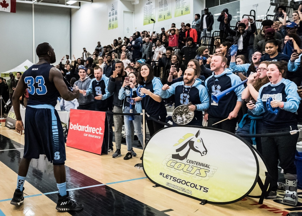 TORONTO, ON – Mar. 4, 2017: After scoring the championship-winning bucket, Brian Owusu celebrates alongside Bruins fans.