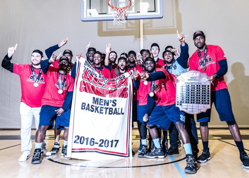 TORONTO, ON – Mar. 4, 2017: The Sheridan Bruins celebrate winning the 2017 OCAA Men's Basketball Championship.
