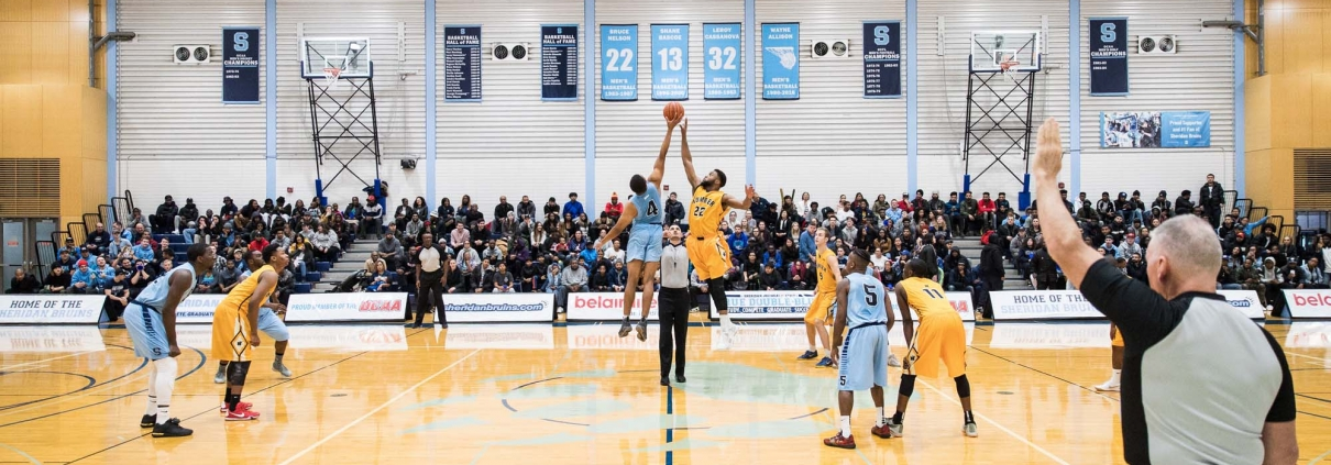 BRAMPTON, ON - NOV. 23, 2017: Tip off at the 118th edition of 'The Game' between the Sheridan Bruins and the Humber Hawks.