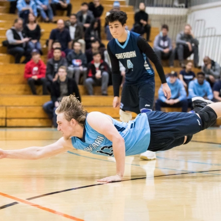 OAKVILLE, ON - NOV. 18, 2017: Liam Butchereit of the Sheridan Bruins dives for the ball in an OCAA men's volleyball game against the Humber Hawks.