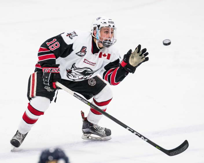 GEORGETOWN, ON - JAN. 31, 2018: Brendan D'Agostino of the Georgetown Raiders catches a flying puck.