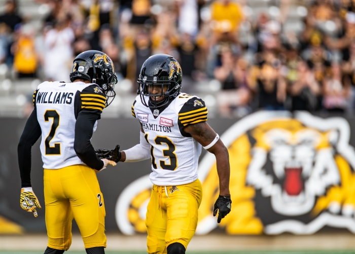 HAMILTON, ON - JUL. 28, 2018: Chris Williams and Jalen Saunders of the Hamilton Tiger-Cats celebrate a fourth quarter touchdown.